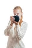Young girl with digital camera, taking a picture. Isolated on white Stock Image