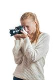 Young girl with digital camera, taking a picture. Isolated on white Stock Images