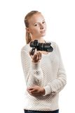 Young girl with digital camera, taking a picture. Isolated on white Royalty Free Stock Photos