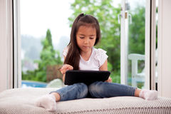 Young Girl with Digital Tablet Stock Photo