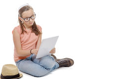 Young girl with a digital tablet Royalty Free Stock Photos