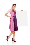 Young girl with dirndl dress holding billboard Royalty Free Stock Photo