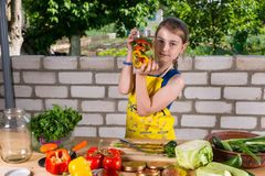 Young girl displaying a bottle of fresh vegetables stock images