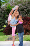 Young Girl Displays Extreme Flexibility. Young girl practicing flexibility drills for cheerleading Stock Photo