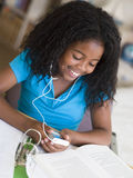Young Girl Distracted From Her Homework Stock Photography