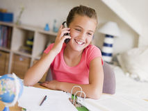 Young Girl Distracted From Her Homework Royalty Free Stock Images