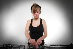 Young girl DJ mixing music Royalty Free Stock Photography