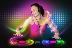 Young girl DJ plays a color vinyl Stock Photos