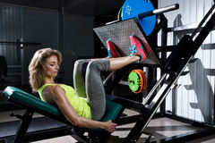 A young girl does a bench press in the gym royalty free stock images