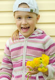 The young girl does a wreath of yellow flowers of a dandelion Stock Photography
