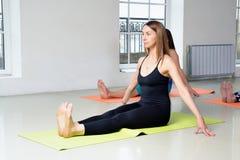 Young girl does yoga exercise Stock Photos
