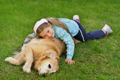 Young girl and dog Stock Images