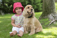 Young girl with dog on field Royalty Free Stock Images