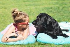Young girl and dog. Stock Image