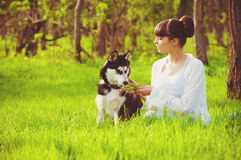 Young girl with a dog Husky spring Royalty Free Stock Photo