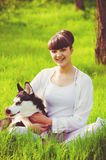 Young girl with a dog Husky spring Stock Images