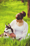 Young girl with a dog Husky spring Royalty Free Stock Photography