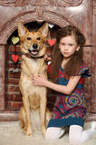Young girl with dog Royalty Free Stock Images