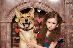 Young girl with dog Stock Image