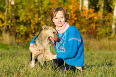 The young girl with a dog outdoors Royalty Free Stock Photography