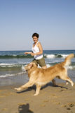 Young girl and dog playing Royalty Free Stock Images
