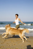 Young girl and dog playing Stock Images