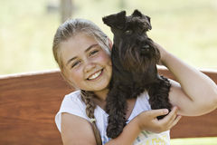 Young girl with dog Stock Photos