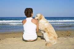 Young girl and a dog sitting Stock Images