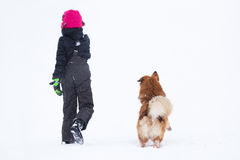 Young girl and dog in a snow landscape Stock Photo