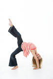 Young Girl Doing Backflip In Studio Royalty Free Stock Image
