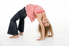 Young Girl Doing Backflip In Studio Stock Photography