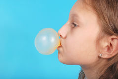 Young girl doing bubble with chewing gum Royalty Free Stock Photo