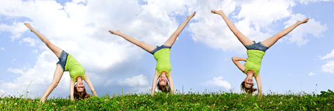 Young girl doing cartwheel. Composite image of young teenage girl doing cartwheel in a summer meadow Royalty Free Stock Photo