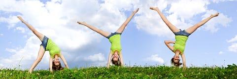 Young girl doing cartwheel Royalty Free Stock Photo