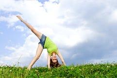 Young girl doing cartwheel stock photography