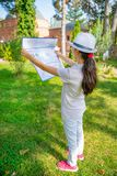 Traveling young girl with map, finds the way and direction. royalty free stock photo