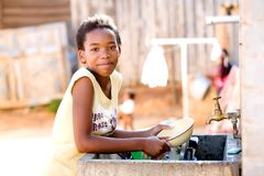 Young Girl Doing Dishes Royalty Free Stock Images