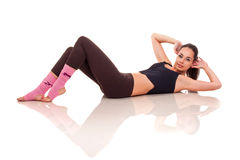 Young girl doing exercises Stock Images