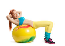 Young girl doing exercises Stock Photos
