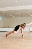 Young girl  doing exercises in a dance class Royalty Free Stock Photography