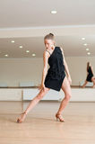 Young girl  doing exercises in a dance class Royalty Free Stock Image