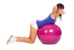 Young girl doing fitness. On the ball Royalty Free Stock Image