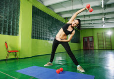 Young girl doing fitness exercise Stock Image