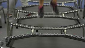 Young girl doing Fitness Exercise on a Mini Trampoline stock video