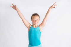 Young girl doing gymastics salute Stock Photo