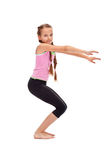 Young girl doing gymnastic exercise Stock Photo