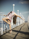 Young girl doing gymnastic exercises on the pier (ancient ver) Stock Images