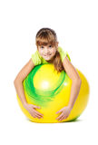 Young girl doing gymnastics with ball Royalty Free Stock Photo