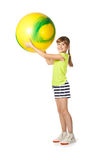 Young girl doing gymnastics with ball Royalty Free Stock Images