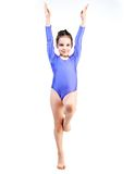 Young girl doing gymnastics. Little girl doing gymnastics isolated on white Royalty Free Stock Photos